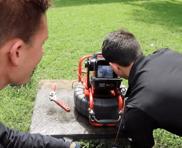 looking for a leak or breakage in a main sewer line with a sewer camera inspection