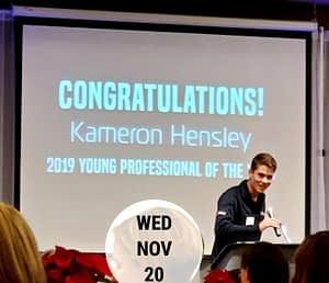 Kameron on stage accepting Young Professional of the Year Award